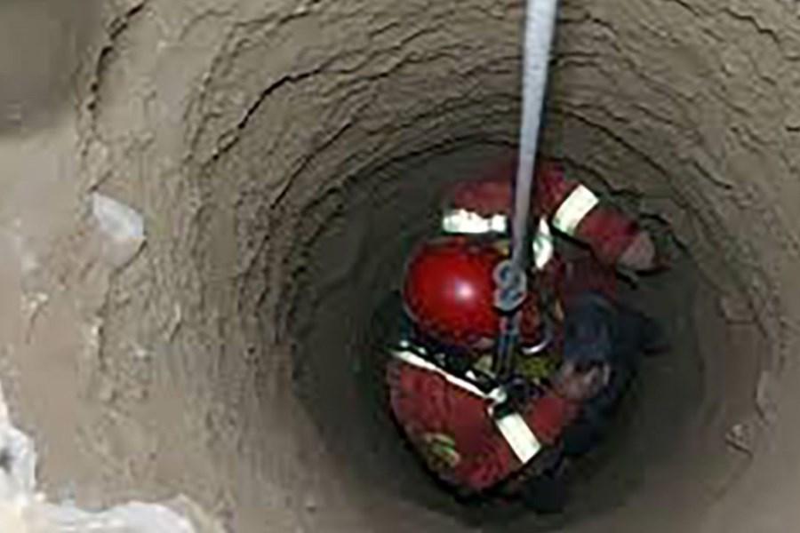 تصویر کشف جسد در چاه عمیق یک باغ